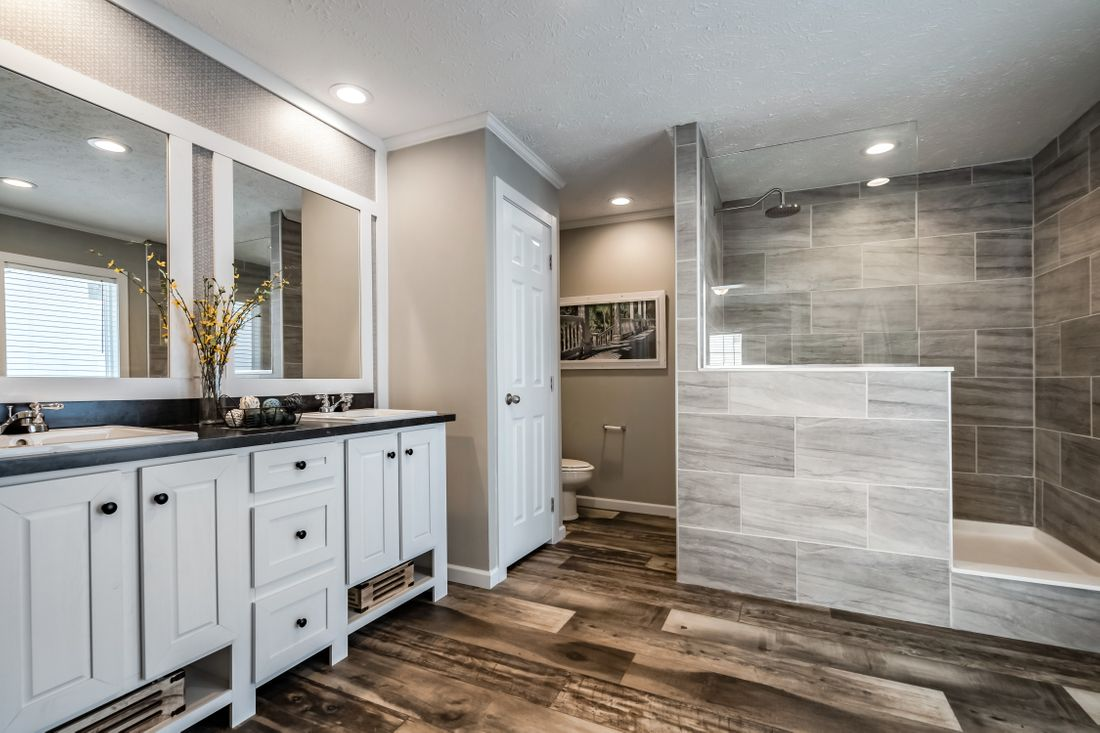 The 7030 HIGH ROCK 6028 Master Bathroom. This Manufactured Mobile Home features 3 bedrooms and 2 baths.