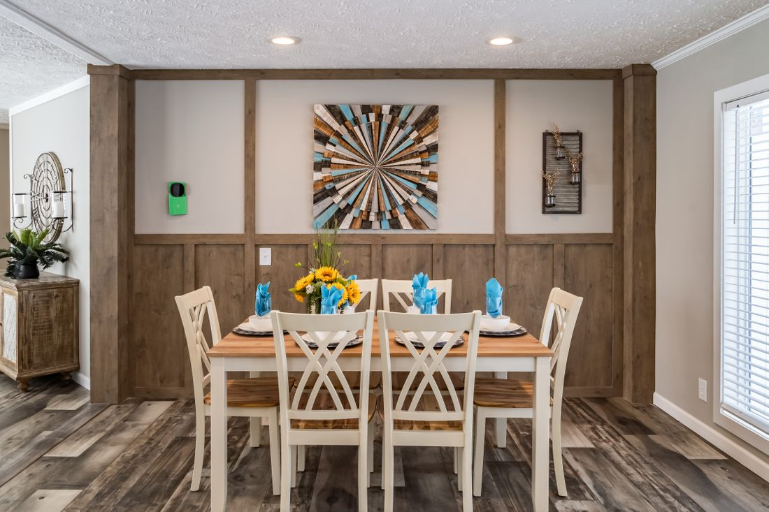 The 7030 HIGH ROCK 6028 Dining Room. This Manufactured Mobile Home features 3 bedrooms and 2 baths.